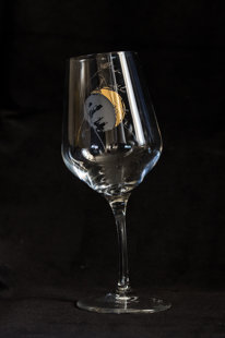Wine glass with the moon and a blade of grass, bent