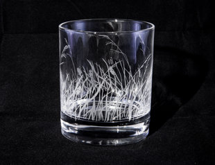 Whiskey glass with a drawing of blades of grass