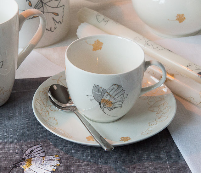 "Teacup with a saucer ""Wind promised skies to a leaf"""